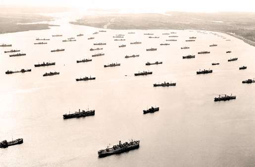 Merchant ships  assemble  in Bedford Basin, Halifax, April 1942. [PHOTO: LIBRARY AND ARCHIVES CANADA—PA112993]