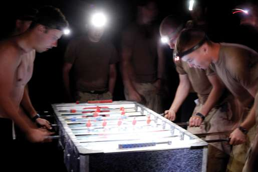 A late-night foosball tournament. [PHOTO: ADAM DAY]