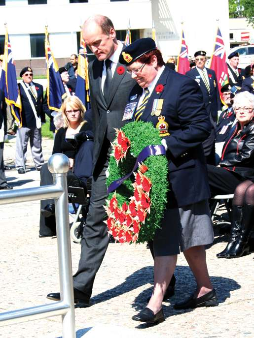 Wim Geerts, Ambassador of the Netherlands, assisted by Legion First Vice Pat Varga, prepares to place a wreath at the cenotaph. [PHOTO: JENNIFER MORSE]