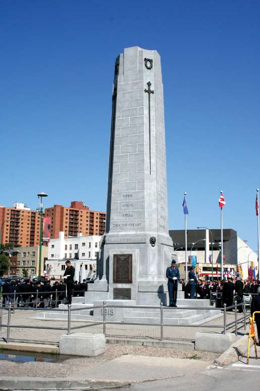 Legionnaires and guests gather around the cenotaph for the ceremony. [PHOTO: JENNIFER MORSE]