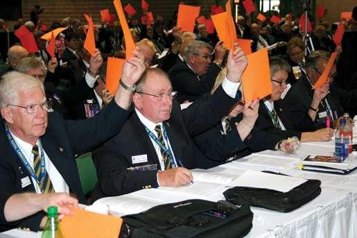 Delegates vote during business sessions. [PHOTO: JENNIFER MORSE]