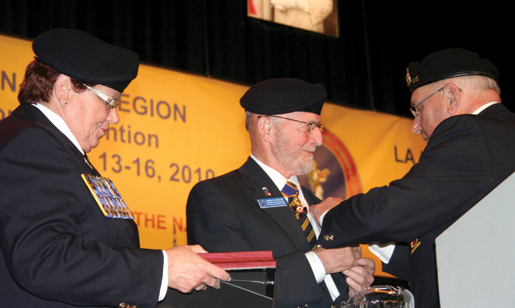 Retiring Grand President Charles Belzile (centre) is congratulated by Dominion President Pat Varga and Past President Wilf Edmond. [PHOTO: JENNIFER MORSE]