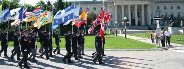 The Dominion Colour Party leads the parade past the Manitoba Legislative Building. [PHOTO: JENNIFER MORSE]