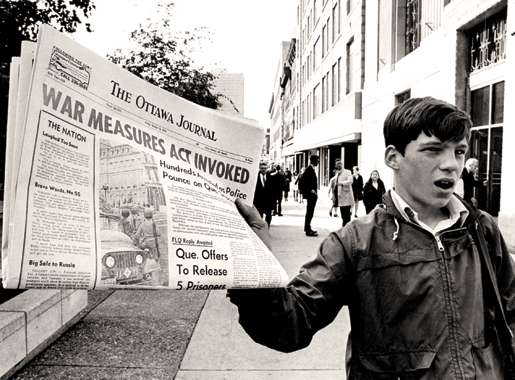 A newsboy hits the streets in Ottawa, Oct. 16, 1970. [PHOTO:  PETER BREGG, THE CANADIAN PRESS]