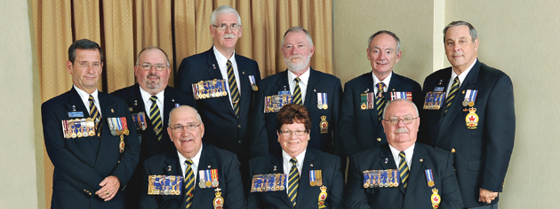 The new Senior Elected Officers of Dominion Command are (front, from left) Past President Wilf Edmond, Dominion President Pat Varga, First Vice Gordon Moore, (rear, from left) Chairman Thomas Irvine, Vice-President Dave Flannigan, Vice-President Tom Eagles, Vice-President George O'Dair, Grand President Larry Murray, Treasurer Mike Cook. [PHOTO: PATRICK RILEY]