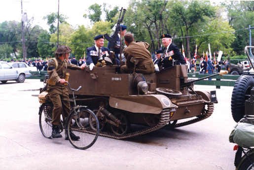 Veterans at the 37th dominion convention in 1998 ride antique military vehicles in the parade. [PHOTO: LEGION MAGAZINE ARCHIVES]