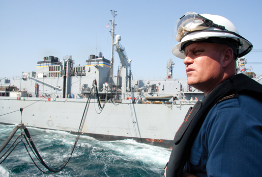 Fredericton's Chief Bo's'n Mate, Chief Petty Officer Gerry Ross, observes a fuel replenishment at sea. [PHOTO: DAN BLACK]