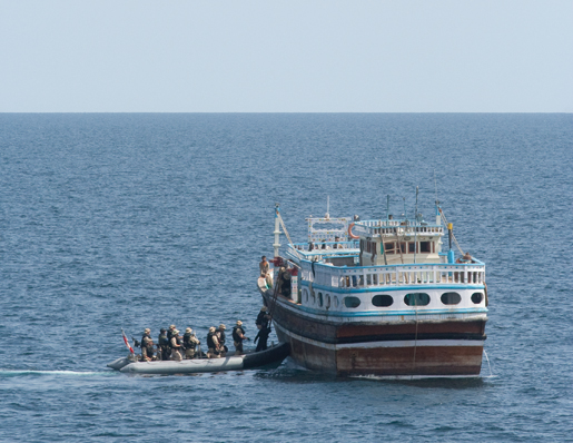 The naval boarding party investigates a dhow. [PHOTO: DAN BLACK]