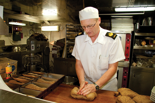 Petty Officer 2nd Class Keith O'Brien in the galley. [PHOTO: DAN BLACK]