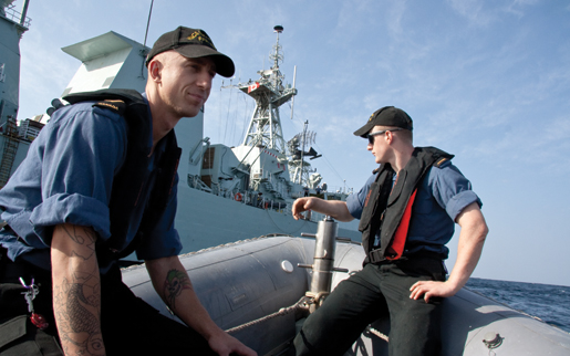 Sailors wait their turn during RHIB-sticking off HMCS Fredericton's starboard side. [PHOTO: DAN BLACK]