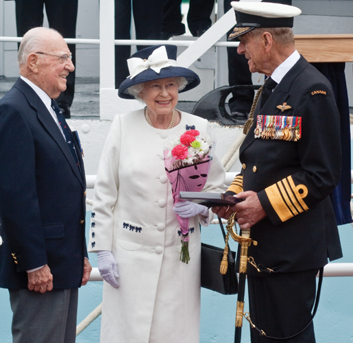 Former corvette commander Murray Knowles greets the Queen and Prince Philip. [PHOTO: TOM MacGREGOR]