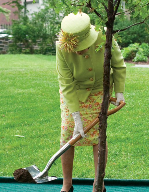 The Queen plants an English oak at Government House. [PHOTO: TOM MacGREGOR]
