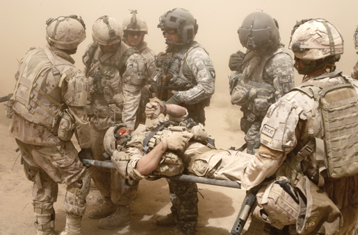 Master Corporal Ken Wilson and the American medevac team that rescued him. [PHOTO: ADAM DAY]