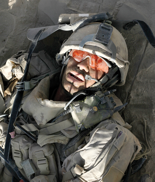 Master Corporal Ken Wilson  on a stretcher, a few minutes after being wounded. [PHOTO: ADAM DAY]