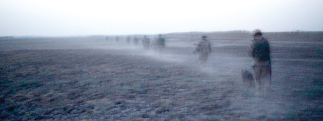 Oscar Company just after dawn, crossing a field near Chalghowr. [PHOTO: ADAM DAY]