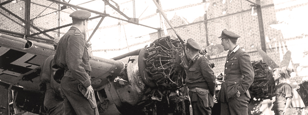 Allied officers examine a damaged German aircraft at Carpiquet airport in Normandy, July 1944. [PHOTO: KEN BELL, LIBRARY AND ARCHIVES CANADA—PA162519]