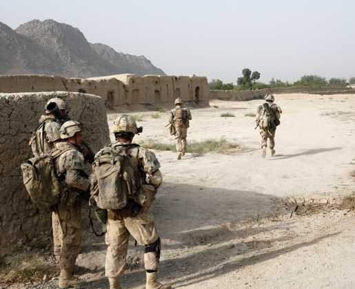 This was the moment everything had been building towards. The Canadians knew the enemy were in an ambush position just ahead. They were about to walk into the open and spring a trap on the insurgents. First they had to get ready. The weapons detachment came forward and prepared their heavy weapons for battle. They sent two men running somewhat perilously out to a forward position. [PHOTO: ADAM DAY]