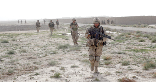 The patrol heads out into the open field. This picture was taken only moments before the sniper's second kill. [PHOTO: ADAM DAY]