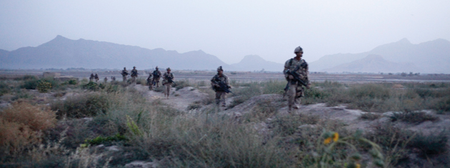 Just after dawn, Oscar Company heads south across the fields and into Salavat. [PHOTO: ADAM DAY]