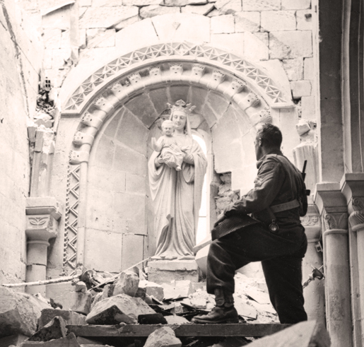 A Canadian soldier inside the ruins of a church at Carpiquet. [PHOTO: LEGION MAGAZINE ARCHIVES]