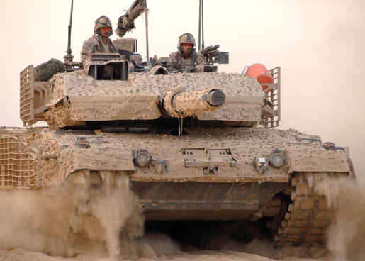 Armoured soldiers from 3rd Battalion, Royal Canadian Regiment Battle Group, rumble toward their assigned position in Afghanistan aboard a Leopard 2 battle tank, November 2008. [PHOTO: CORPORAL JAMES NIGHTINGALE, JTF-AFG ROTO 6]