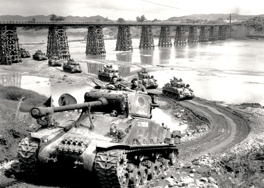 Sherman tanks of B Squadron, Lord Strathcona's Horse, on the move in Korea, July 16, 1952. [PHOTO: PAUL E. TOMELIN, LIBRARY AND ARCHIVES CANADA—PA115496]