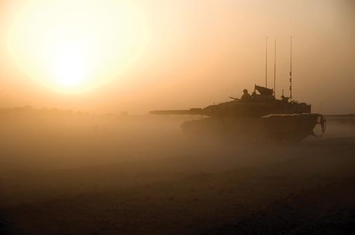 The blazing sun silhouettes a Leopard tank in the dust near Mushan, Afghanistan, August 2009. [PHOTO: CORPORAL JONATHAN JOHANSEN]