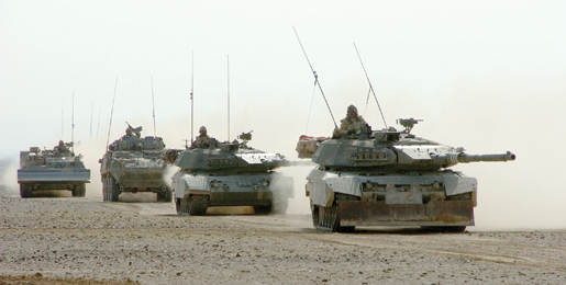 Two Leopard tanks lead a convoy of armoured vehicles west of Kandahar, Afghanistan, December 2006. [PHOTO: SERGEANT DENNIS POWER, ARMY NEWS-SHILO]