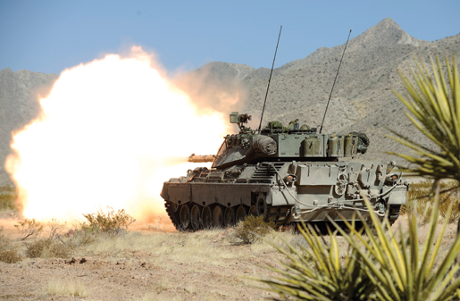 A Leopard tank blasts away at a target during a training exercise involving members of the Lord Strathcona's Horse and Royal 22nd Regiment at Fort Bliss, Texas. [PHOTO: CORPORAL MARC-ANDRE GAUDREAULT, PHOTO SECTION CFB VALCARTIER]