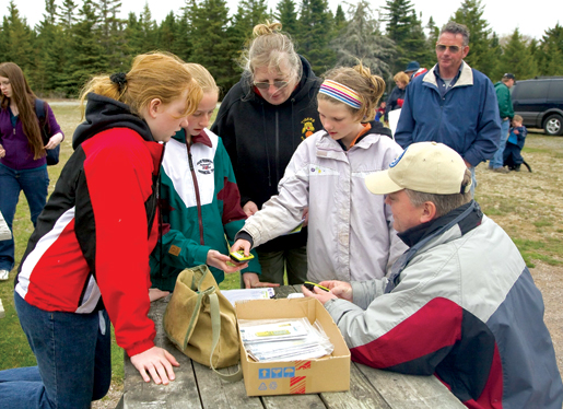 Locating a cache in Fundy National Park. [PHOTO: PARKS CANADA]