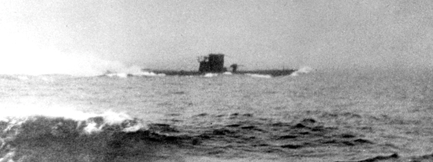 German U-boat U-210 under attack in the Atlantic. The photo was taken from the deck of HMCS Assiniboine, August 1942. [PHOTO: G.E. SALTER, LIBRARY AND ARCHIVES CANADA—PA037443]