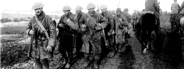 Mud-spattered and exhausted Canadian soldiers return from their trenches on the Somme, November 1916. [PHOTO: WILLIAM IVOR CASTLE, LIBRARY AND ARCHIVES CANADA—PA000832]