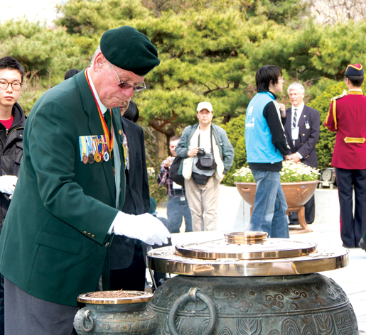 Korea Veterans Association of Canada National President John Bishop participates in the Korean National Cemetery service. [PHOTO: DAN BLACK]