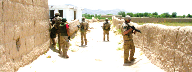 Near Zangabad in 2008 as a Canadian patrol dares to go no further into enemy territory. [PHOTO: ADAM DAY]