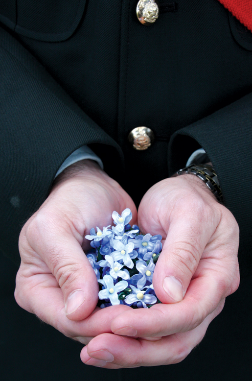 Sgt. James Prowse cradles forget-me-nots. [PHOTO: SHARON ADAMS]