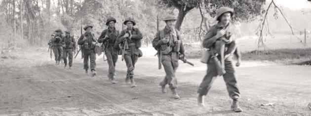 Canadian infantry in Normandy, July 18, 1944. [PHOTO: HAROLD G. AIKMAN, LIBRARY AND ARCHIVES CANADA—PA162447]