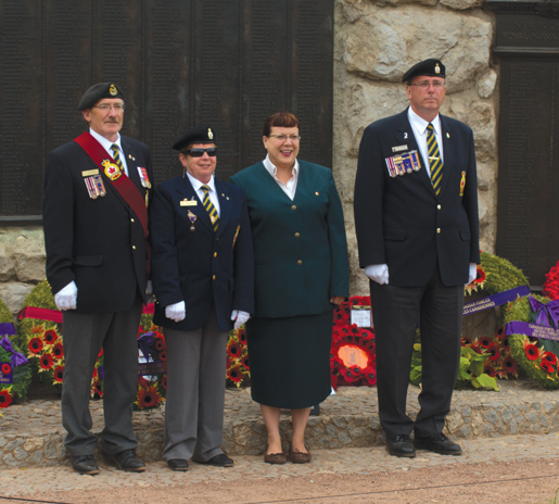Joining VAC's Arlene King at the Beaumont Hamel Memorial are Newfoundlanders (from left) Silas and Jacqueline Thompson and Ed Fewer. [PHOTO: TOM MacGREGOR]