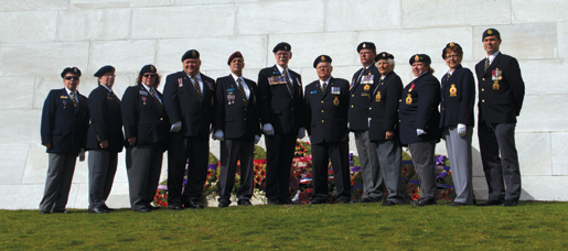 At the Vimy Memorial are (from left) Jacqueline Thompson, Joyce Phillips, Patricia Duffy, Scott Briand, Jean-Pierre Asselin, Dominion Vice-President Tom Eagles, Bill Maxwell, George DeRabbie, Dorothy Butler, Connie Wilson, Sheila Donner and Aaron Bedard. [PHOTO: TOM MacGREGOR]