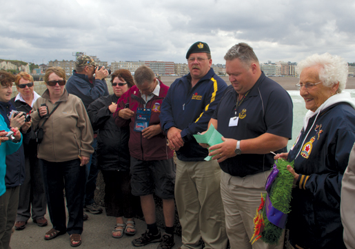 Scott Briand reads the Naval Prayer at Dieppe. [PHOTO: TOM MacGREGOR]
