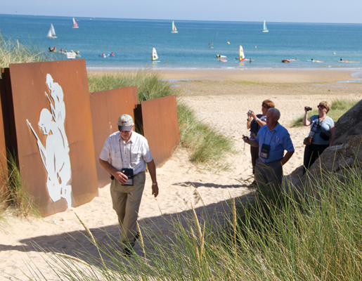Pilgrims walk along Juno Beach. [PHOTO: TOM MacGREGOR]