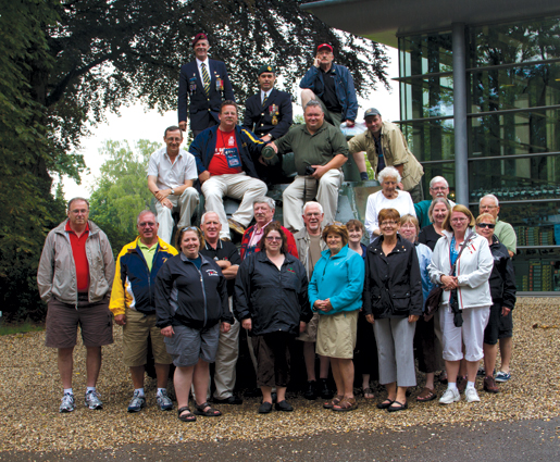 The group poses with a Sherman tank at Oosterbeek. [PHOTO: TOM MacGREGOR]