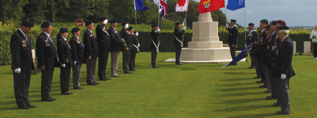 The pilgrims form up at the Dieppe Canadian War Cemetery. [PHOTO: TOM MacGREGOR]