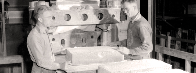 Workers at the Polymer Rubber Corporation plant.
