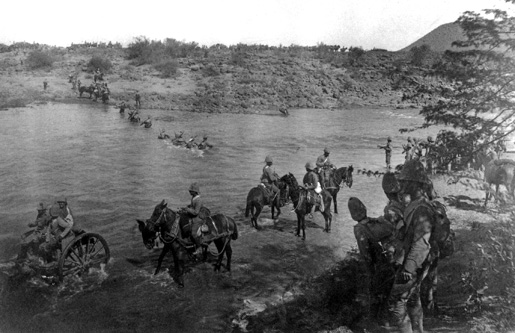 Troops of the Royal Canadian Regiment crossing Paardeberg Drift.