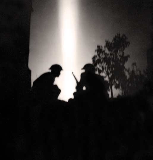 Silhouettes of Canadian infantry during the July 25, 1944, night attack. [PHOTO: MICHAEL M. DEAN, LIBRARY AND ARCHIVES CANADA—PA131384]