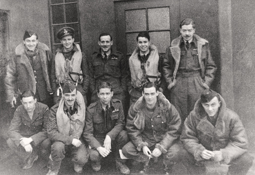 William McRae (standing, fourth from left) shares a moment with other 132 Squadron pilots, late 1941. [PHOTO: McRAE FAMILY COLLECTION]