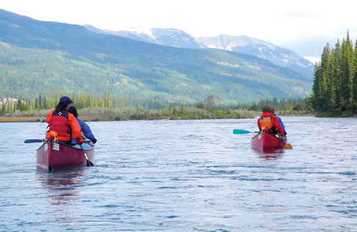 River guide Jason Kuruc and instructor Megan Mulligan head down the North Saskatchewan with corporals Laura Byrne and Jeannie Daly. [PHOTO: DAN BLACK]