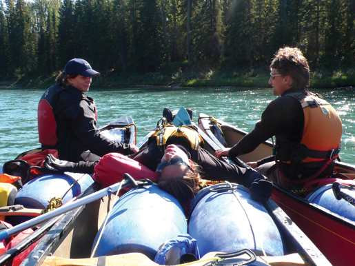 After joining canoes, the participants relax as a section of gentle river carries them onward. [PHOTO: DAN BLACK]