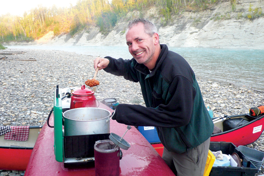 Instructor Scott Gullion helps prepare  breakfast near Devil's Elbow. [PHOTO: DAN BLACK]