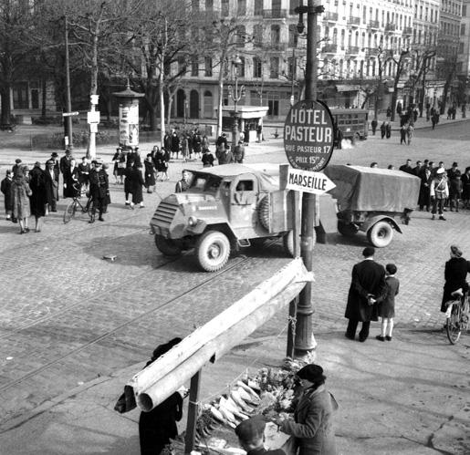 Armoured truck of the 5th Canadian Armoured Division crossing the Guillotiers Bridge over the Rhone River during Operation Goldflake.